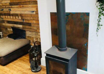 Decorative Aged Copper Sheet Behind Log Burner