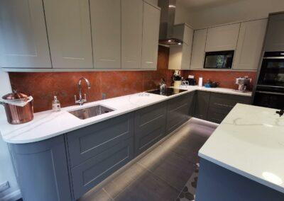 aged copper splashbacks across whole kitchen