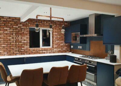 Antiqued copper backsplash in kitchen