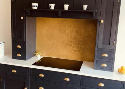 Antiqued brass kitchen splashback
