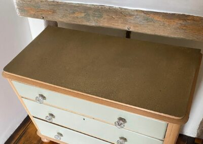 Cupboard finished with aged brass sheet