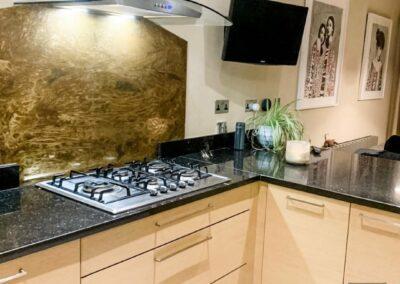 aged brass custom cut kitchen splashback