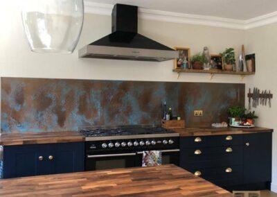 long copper verdigris splashback in kitchen