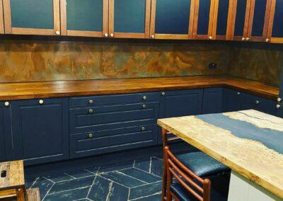 verdigris copper splashback in trendy kitchen